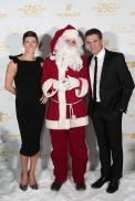 TV commentator and his wife with Santa