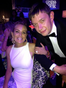 March 2014 - Vasily Klyukin with Sharon Stone at amfAR where he bid over 1 million Euros for a trip to space with Leonardo di Caprio
