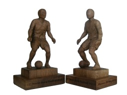 Wooden twin trophies created by artist Osvaldo Moi