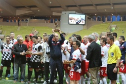 Prince Albert lifting the trophy