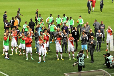 The whole team applauding the fans