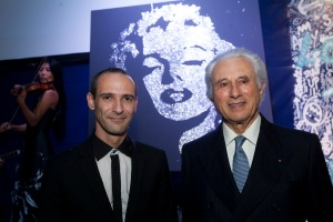 Artist Erik Black w: his artwork painted live during the party posing w:Adriano Ribolzi @Sidney Guillemin