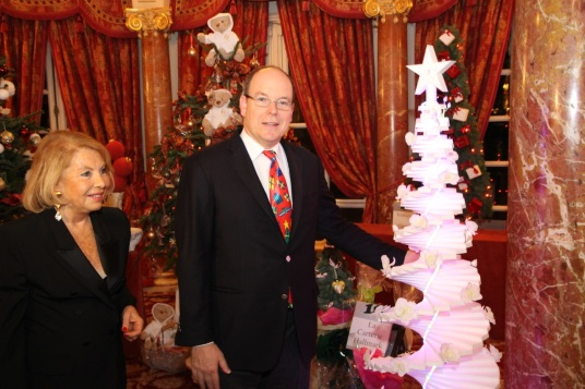 Louisette Levy Soussan and Prince Albert with the Woman of the Year Award tree with beauty products from Alliance Boots