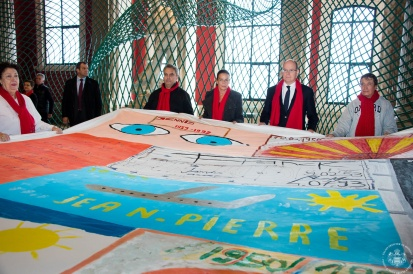 Princess Stephanie and Prince Albert holding the Memory Quilt