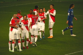 Matheus embraced by Abdennour after scoring, with other teammates and Modesto from Bastia looking down @CelinaLafuenteDeLavotha