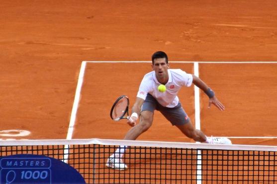 Djokovic at the net Apr16, 2015 @CelinaLafuenteDeLavotha