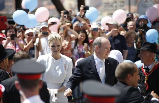 Prince Charlene and Prince Albert greeting the crowd in the Palace Square