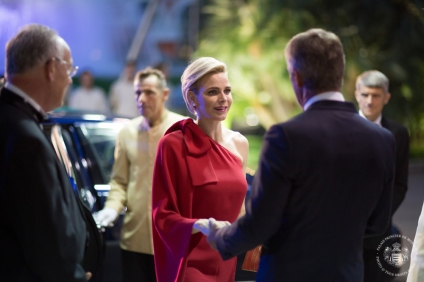 Princess Charlene welcomed by Mr. Narmino, President of the Monaco Red Cross on arrival at the Salle des Etoiles @Frederic NEBINGER Palais Princierjpg