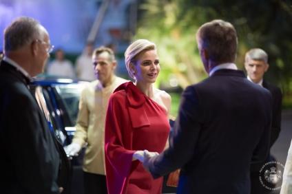 Princess Charlene welcomed by Mr. Narmino, President of the Monaco Red Cross on arrival at the Salle des Etoiles @Frederic NEBINGER Palais Princierjpg