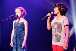 Children singing during Kids Nite