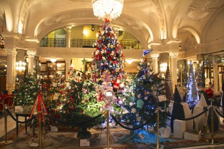 View of the forest of Christmas trees ready for the charity auction in the lobby of the Hotel de Paris @CelinaLafuenteDeLavotha