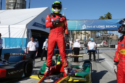 Di Grassi on top of his racing car in Long Beach ePrix @P1 Media Relations ABT Schaeffler Audi Sport