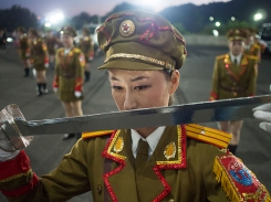 Dancer, Ri Hyang Yon, during a practice session for the Arirang Games in the car park of the May Day Stadium by Nick Danziger