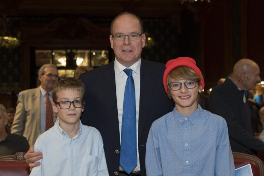Prince Albert with young Monegasque actors Mathieu Gormotte and Tom Chalot in the red bonnet during the avant-premiere of The Odyssey at the Oceanographic Museum of Monaco@M. Dagnino