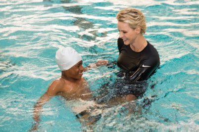 HSH Princess Charlene teaching children to swim SouthAfrica-Monaco Rugby Exchange @Gaetan Luci:Palais Princier