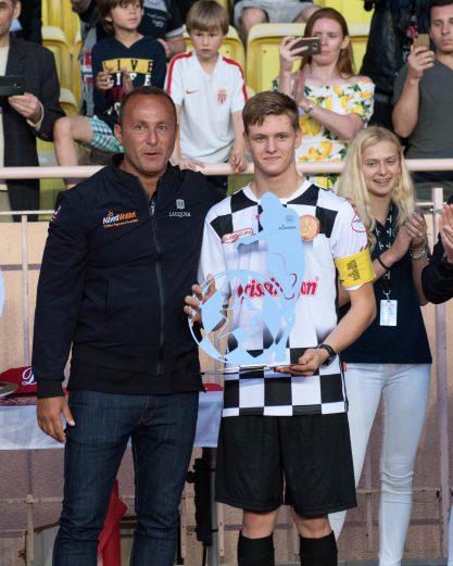 Mick Schumacher, son of Michael Schumacher with the F1 Pilots' Team trophy Copyright-A.S Star Team for the Children - J.M Follete