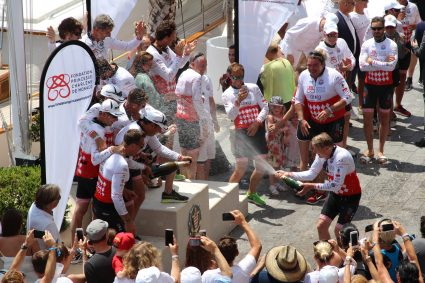 Mika Hakkinen spraying champagne to th winners on the podium as it is customary in F1 @CelinaLafuentedeLavotha