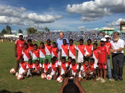 Prince Albert and Father Pedro Opeka with the children in the football field of Madagascar @MAP