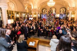 Prince Albert and bidders on the lobby of the Hotel de Paris during the charity auction @Philippe Fitte