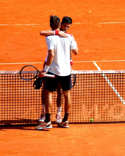 Novak Djokovic embracing Borna Coric after defeating the Croatian on April 18, 2018@CelinaLafuentedeLavotha