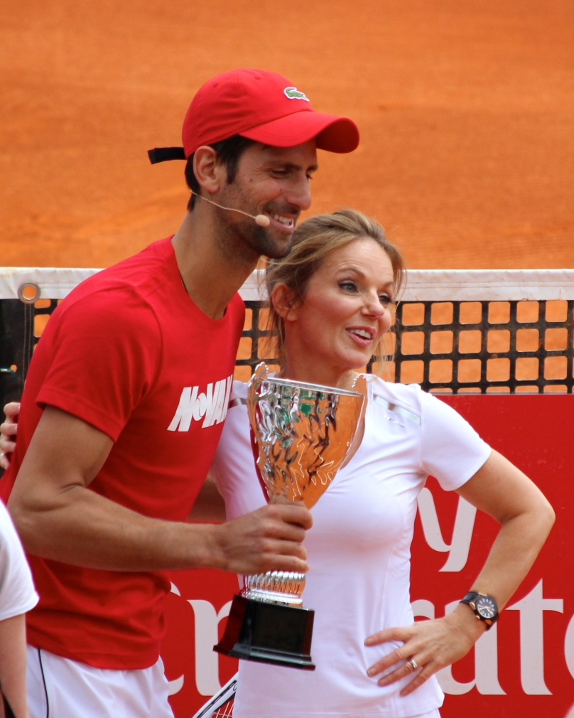 Novak Djokovic presenting a trophy to Geri Halliwell at tennis charity exhibition RMCM 2018 @CelinaLafuentedeLavotha