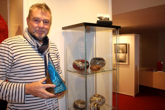 Yvon Kergal curator of GemlucArt 2018 posing with his artworks @CelinaLafuentedeLavotha