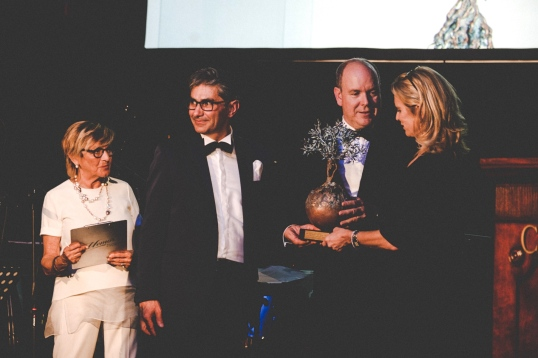 HSH Prince Albert II of Monaco receiving an award from Kerry Kennedy and artist Andrea Roggi @Magazzino 77