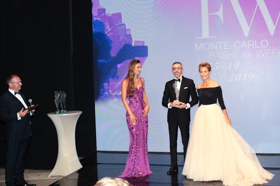 Blue Award presented to Maurizio Marino on behalf of the House of BREGUET, model Lara Leito and Celina Lafuente de Lavotha, Communications Attache MCFW @Daniele Guidetti,