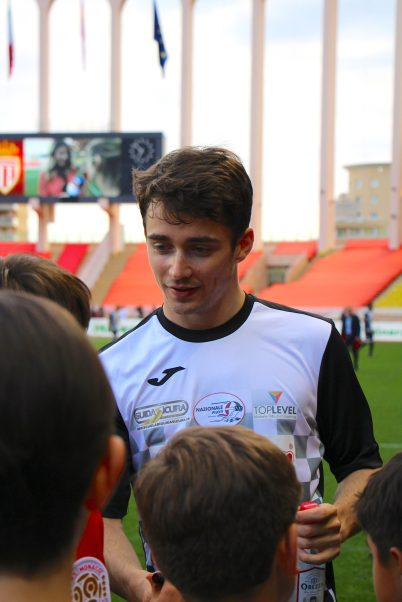 Monegasque Ferrari F1 driver Charles Leclerc signing autographs before charity football match @CelinaLafuentedeLavotha