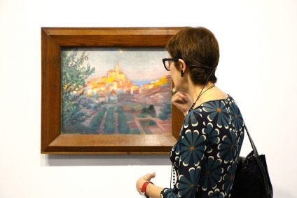 Curator Montse Aguer presenting the artwork Cadaques seen from the Back V.1921, Oil on Canvas, Figueras, Foundation Gala-Salvador Dali @CelinaLafuentedeLavotha, Monaco 2019