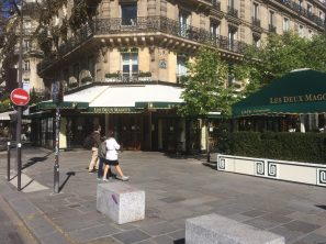 Lonely tourists strolling by an empthy Les Deux Magots, Paris, April 5, 2020 @Lorene Edelstam