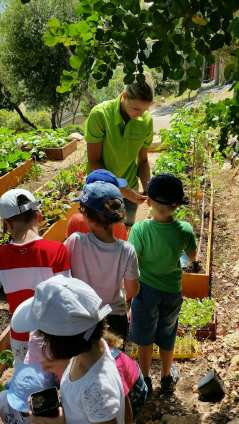 Jessica Sbaraglia and children in one of the vegetable gardens managed by Terre de Monaco @TDM